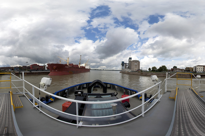 Panoramic photograph taken aboard a tug on the Richelieu River to see the grain elevators near the St. Lawrence.