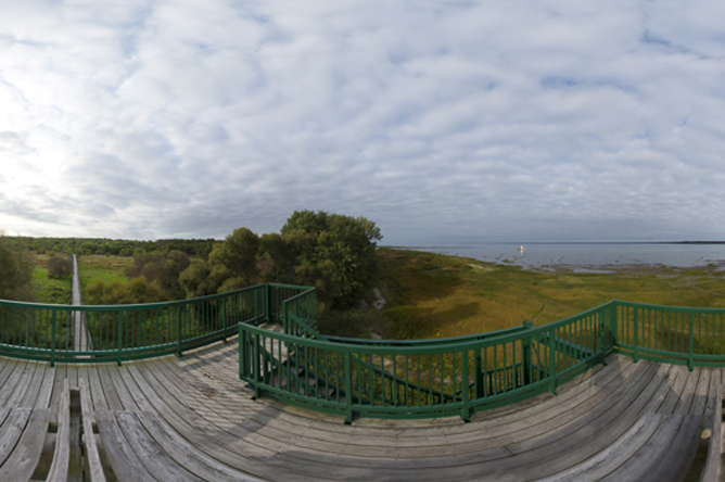 Panoramic photograph taken from the top of the tower in Anse du Port ecological park overlooking the St. Lawrence River and the walkway