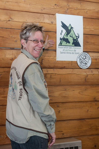 Carole Deschenaux displays the new logo of the Association des chasseurs et pêcheurs de Sainte-Anne-de-Sorel.